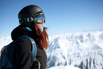 Woman on summit in alps