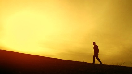 Man Walking Up Hill Mountain Climb Sunset Silhouette