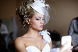 bride blond girl in white wedding dress looking in the mirror
