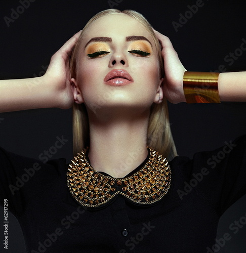 sexy stylish blond model with bright yellow makeup