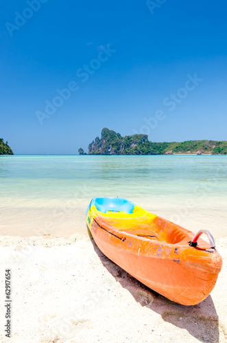 Kayak on the beach with blue sky