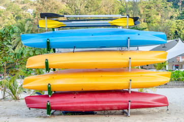Stacke of colorful kayak