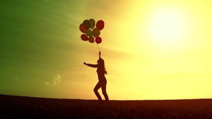 Beautiful female Silhouette Running Free Balloons