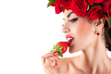 beautiful fashion model eating strawberry