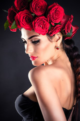 portrait of beauty fashion model with red roses hairstyle