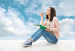 Girl teenager thinking inspiration or write idea on sky