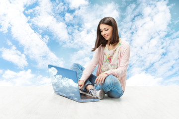 young woman and notebook over blue sky