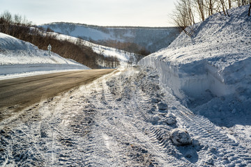 Snowdrifts and road