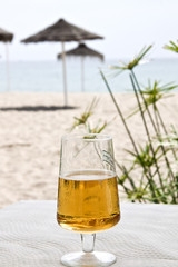 Beer cup on the beach.