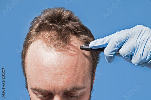 Man's Forehead Latex Hand