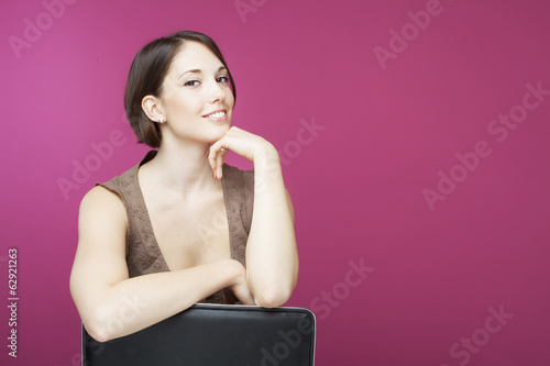 Beautiful young woman on pink background