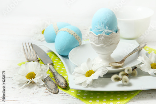 Easter table setting with flowers and eggs