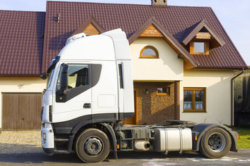 Truck in front of  suburban house