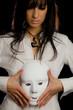 beautiful woman holding  a white mask