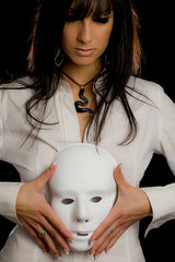 beautiful woman holding  a white mask