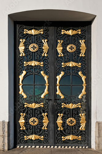 closed metal door with decorative grille