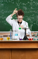 Mad professor conducts some chemical experiments