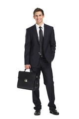 Full-length portrait of businessman handing briefcase, isolated
