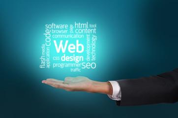 Businessman hand holding Web Design text wording