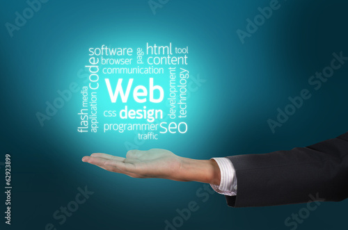 Businessman hand holding Web Design text wording