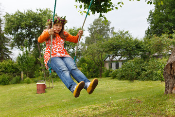 Litlle girl in swings