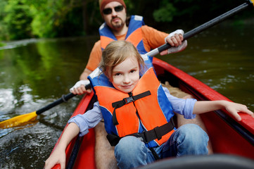Little girl and her father on a kayak