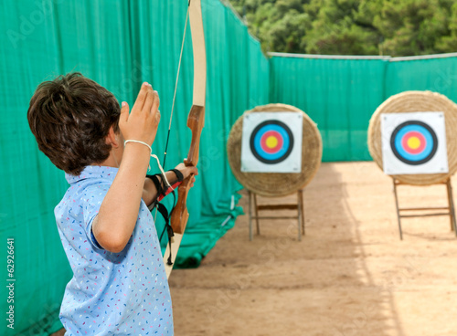 portrait of a child, archery, rear view