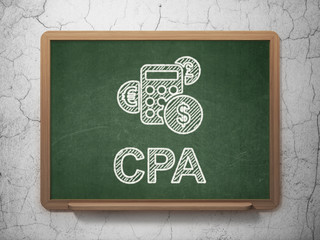 Finance concept: Calculator and CPA on chalkboard background