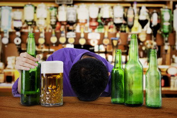 Alcoholic sleeping in the bar