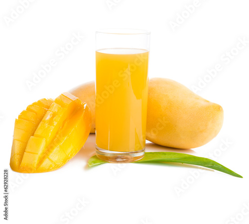 Glass of fresh mango smoothie on white.