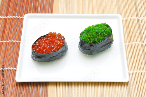 Gunkan with caviar on a plate
