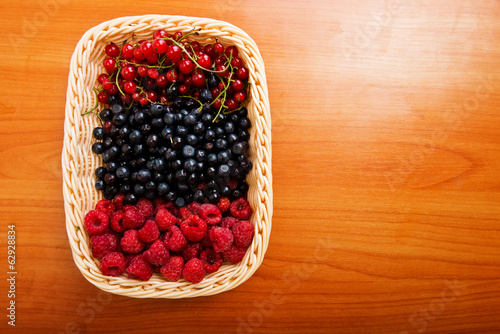 Mix of different berries in basket