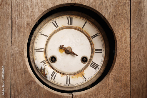 old broken wall clock