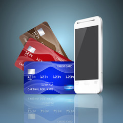 Mobile phone with credit cards on gray background. Mobile paymen