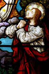 Jesus praying in stained glass