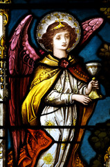 Angel holding a cup, in stained glass.