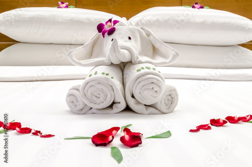 Bed decoration with red flowers and elephant