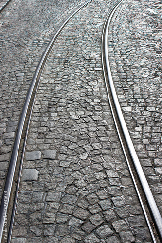 Old cobblestone street with rails