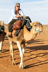 Tourist on a camel in the desert from Morocco