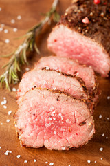 Roast beef on wooden board