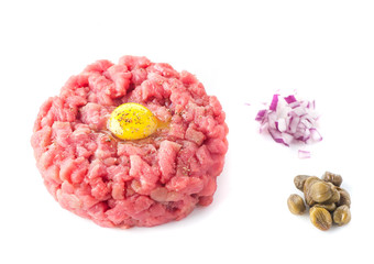 Beef tartare with spices on a white background