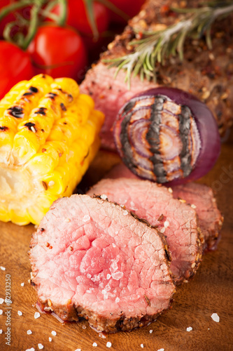 Roast beef with cherry tomatoes, corn and spices