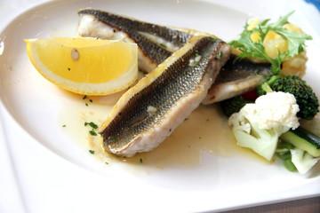Fresh haddock fillets in butter sauce on plate Denia Spain