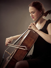 Smiling Cellist playing her old cello