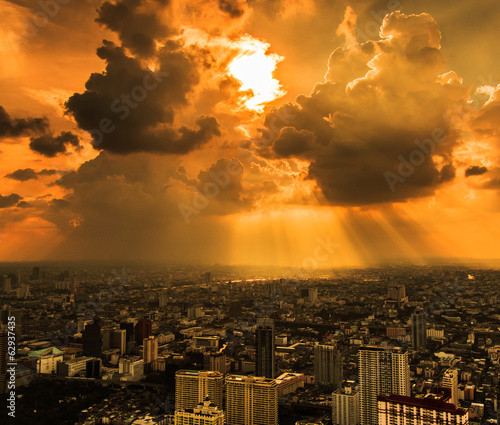 Rays of light shining through dark clouds in Bangkok of Thailand