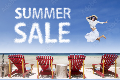 Beach chairs and girl jumping for summer sale