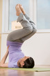 Woman in a traditional stretching yoga pose at home or gym