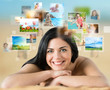 Woman laying on beach with lots of pictures around her
