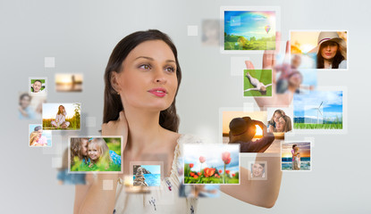 Portrait of young happy woman sharing her photo and video files