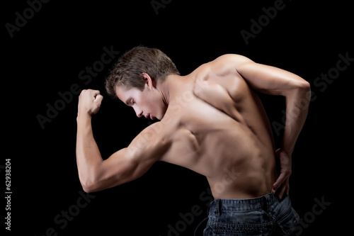 Image of handsome muscular man showing his biceps